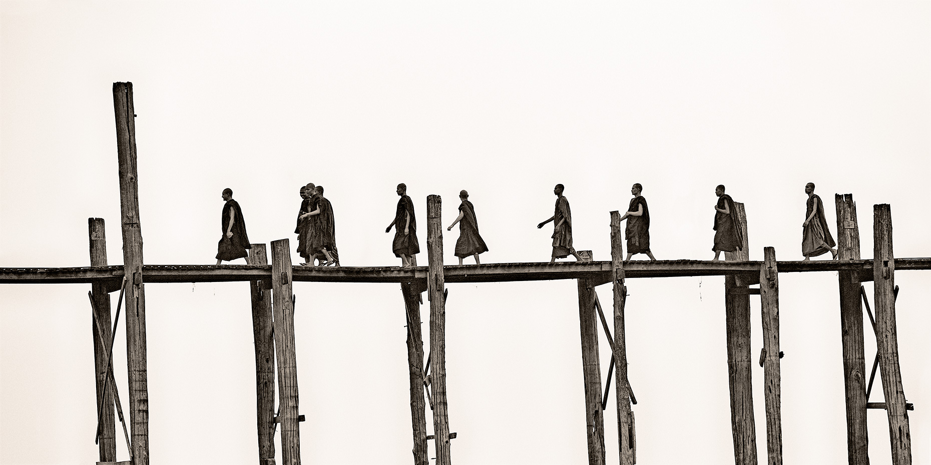 monks on u-bein bridge
